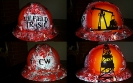 red and white oilfield hard hat custom painted with derrick